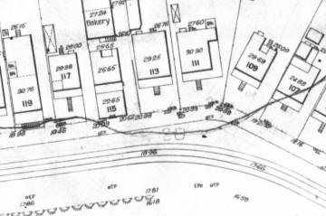 A section of plan no. 771 (above) showing details of houses, tram tracks, an embankment and a contour line.