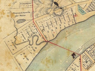 The revised town boundary is marked on red on this map dating from 1858.