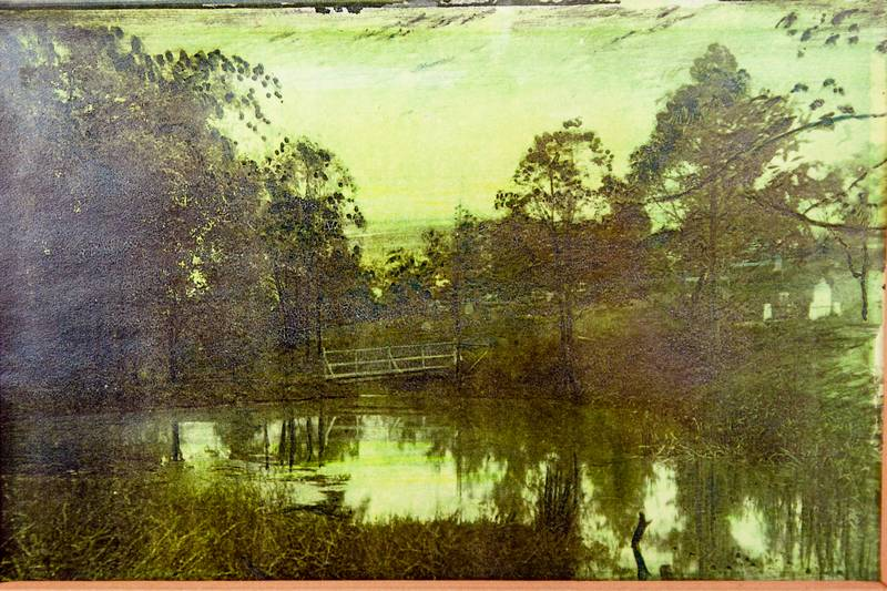 This hand-tinted photograph of the dam hangs in the cemetery museum.