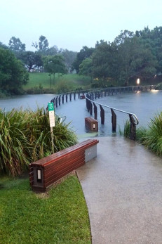 The bridge over the UQ lakes had gone under by 5pm.