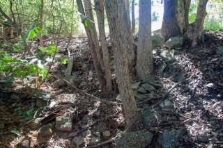 The northern bank of the creek is full of rubble, suggesting that the land has been filled in.